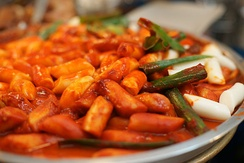 Tteokbokki, rice cakes with spicy gochujang sauce.