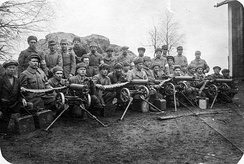 Around 30 soldiers of the paramilitary White Guard pose for the camera together with four Maxim heavy machine guns.