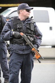 A RCMP officer in 2010 armed with a shotgun outfitted to fire beanbag rounds