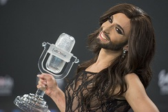 Conchita holding the Eurovision trophy after winning the contest