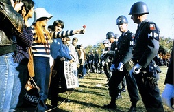 An anti-war demonstrator offers a flower to a Military Police officer during the National Mobilization Committee to End the War in Vietnam's 1967 March on the Pentagon