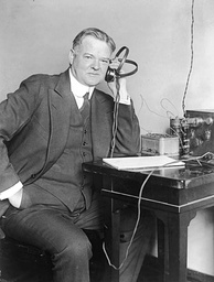 Herbert Hoover listening to a radio receiver