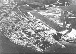 Hickam Field, 1940. Pearl Harbor Navy Yard is in the upper left corner and the main barracks is immediately left of the eight hangars in the center.