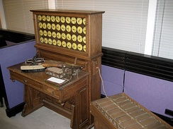 "Replica of Hollerith tabulating machine with sorting box, circa 1890. The ""sorting box"" was an adjunct to, and controlled by, the tabulator.  The ""sorter"", an independent machine, was a later development.[11]"