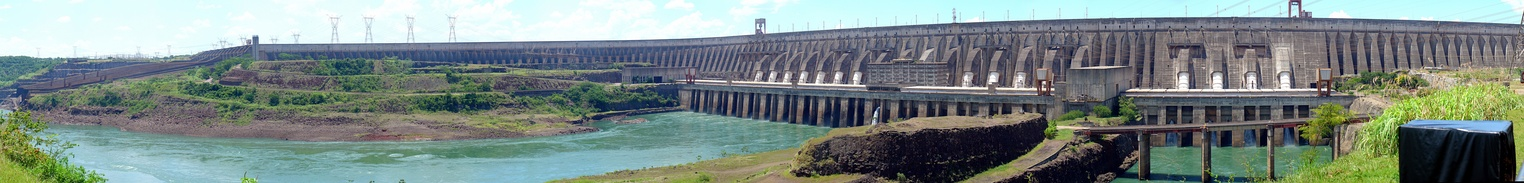 Panoramic view of the Itaipu Dam, with the spillways (closed at the time of the photo) on the left. In 1994, the American Society of Civil Engineers elected the Itaipu Dam as one of the seven modern Wonders of the World.[19]