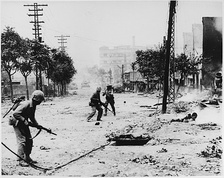 U.S. Marines engaged in street fighting during the liberation of Seoul, September 1950