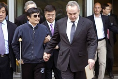 Civil rights activist Chen Guangcheng (left) with former United States ambassador to China Gary Locke (center) and former Assistant Secretary of State for East Asian and Pacific Affairs Kurt M. Campbell (right) at the U.S. Embassy in Beijing on 1 May 2012