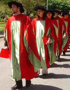 Ph.D. candidates march at Commencement in McGill's scarlet regalia.[164]