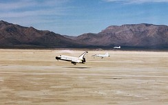 Two T-38 chase planes follow Space Shuttle Columbia as it lands at Northrop Strip in White Sands, New Mexico, ending its mission STS-3.