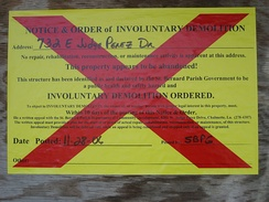 """Involuntary Demolition"" notice, posted on buildings in St. Bernard Parish when there has been no significant effort to gut, secure, or repair the building over a year after Hurricane Katrina."
