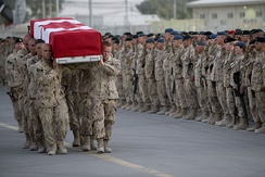 Canadian Forces personnel carry the casket of a fallen comrade onto an aircraft at Kandahar Air Field, 17 July 2009