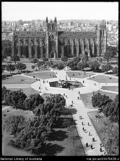 Avenue in Hyde Park, circa 1935, showing St Mary's Cathedral before its spires were added.