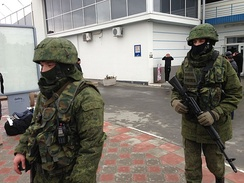 Russian troops with unmarked uniforms on patrol at Simferopol International Airport, 28 February 2014