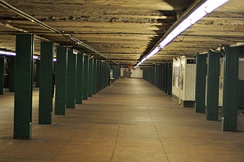 The long and wide mezzanine in the West Fourth Street station in Greenwich Village.