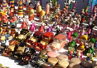 A variety of traditional wooden Channapatna toys from India