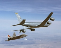 A KC-135R Stratotanker from the 22nd Air Refueling Wing refuels an F-22A Raptor from Edwards AFB, California