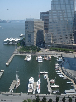 Battery Park City Ferry Terminal (at left) is moored in the Hudson River just north of World Financial Center North Cove