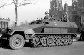 "German World War II-era SdKfz 251 military halftrack, with overlapped interleaved wheels and ""slack track"""