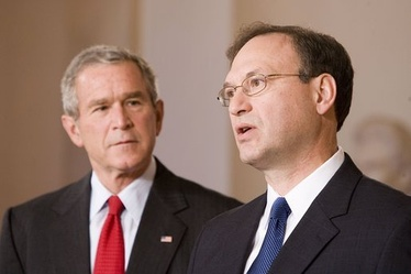Associate Justice Samuel Alito acknowledges his nomination on October 31, 2005, with President Bush looking on.