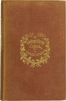 "Brown book cover bearing the words ""A Christmas Carol by Charles Dickens"" in gold."