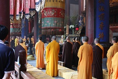 Chinese Buddhist monks performing a formal ceremony in Hangzhou, Zhejiang Province, China.