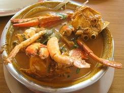Photo of cooked crab in bowl of soup