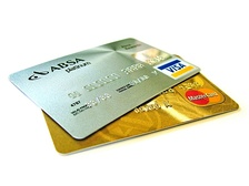 A credit card is a common form of credit. With a credit card, the credit card company, often a bank, grants a line of credit to the card holder. The card holder can make purchases from merchants, and borrow the money for these purchases from the credit card company.