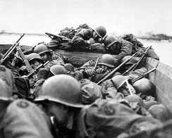 Soldiers from the 89th Infantry Division cross the River Rhine in assault boats, March 1945