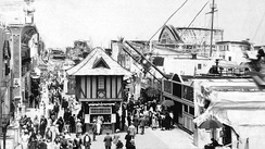 Crowds between 17th and 34th streets, with roller coaster in background, c. 1900–1920
