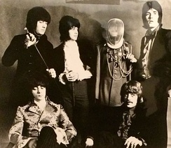 Deep Purple in 1968. Standing, left to right: Nick Simper, Ian Paice and Rod Evans. Seated: Ritchie Blackmore and Jon Lord