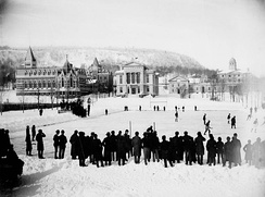 A hockey game on campus in 1884, just seven years after McGill students wrote the then-new game's first rule book, with the Arts Building, Redpath Museum, and Morrice Hall (then the Presbyterian College) visible.