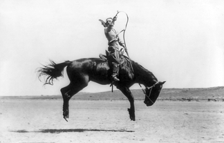 Kitty Canutt, champion lady rider of the world, on Winnemucca, 1919