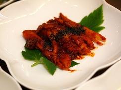 Блюдо корейской кухни: маринованные корни кодонопсиса ланцетного