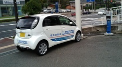 Mitsubishi i-MiEV recharging from an on-street charging station in Japan.