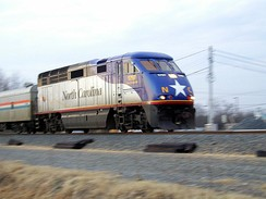 Amtrak's Piedmont near Charlotte, North Carolina, with a state-owned locomotive. This route is run under a partnership with the North Carolina Department of Transportation, 2003