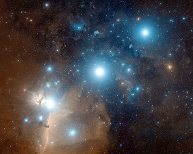 An image of Orion's Belt composited from digitized black-and-white photographic plates recorded through red and blue astronomical filters, with a computer synthesized green channel. The plates were taken using the Samuel Oschin Telescope between 1987 and 1991.