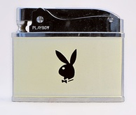 A Playboy cigarette lighter with the distinctive rabbit logo
