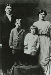 "c. 1916–17. Pictured from left: Father Jack, older brother Neil, Reagan (with ""Dutchboy"" haircut), and mother Nelle"