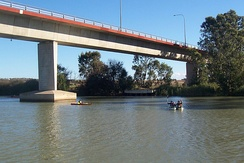 Single box girder bridge (concrete), Australia. A similar bridge on this river was fabricated ashore and pushed across its pylons.