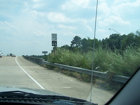 Typical Texas rural speed limit sign before September 2011. Note the black backgrounded 65 mph night speed limit sign, which was common on Texas roads. (No other state had a universal night speed limit.) This sign is on southbound U.S. 69/96/287 just north of Beaumont. Note that night speed limits have been abolished since this photo was taken.