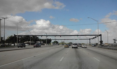 A bulky tubular metal structure. Not only is the intersection very large, but due to its location on Florida's east coast, the traffic lights must be hurricane resistant.