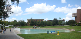 The UCF Reflecting Pond and walkway in front of Millican Hall