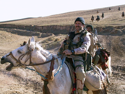 Then-MSgt Bart Decker from the 23rd STS, on horseback in the Balkh valley, during the initial days of the U.S. invasion of Afghanistan in 2001.