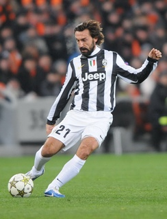 Italian deep-lying playmaker Andrea Pirlo executing a pass. Pirlo is often regarded as one of the best deep-lying playmakers of all time.