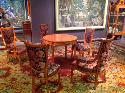 Table and chairs by Maurice Dufrene and carpet by Paul Follot at the 1912 Salon des artistes décorateurs