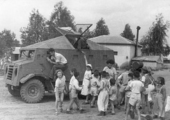 "A ""Butterfly"" improvised armored car of the Haganah at Kibbutz Dorot in the Negev, Israel 1948. The armored car is based on CMP-15 truck. The car has brought supply to the kibbutz. The Negev Kibbutz's[dubious  – discuss] children were later evacuated by those cars from their kibbutz, before an expected Egyptian Army attack."
