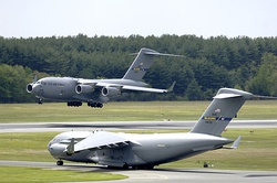 A C-17 Globemaster III from the 305th Air Mobility Wing at McGuire Air Force Base, New Jersey, performs touch and go landings while another C-17 prepares for take-off on Wednesday.