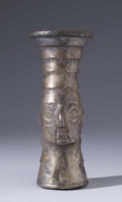 A repoussé silver Chimú kero beaker from Peru that may have been used in drinking rituals with corn beer