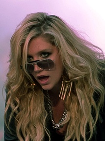 "Kesha's single ""Tik Tok"" from her debut studio album Animal came in at number one, spending nine consecutive weeks at number 1.  Three other singles from her debut also made the Year-End Hot 100, as did one by 3OH!3 on which she was featured."