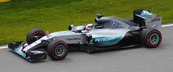 A picture of Lewis Hamilton driving a Mercedes F1 W06 Hybrid formula one car during the 2015 Canadian Grand Prix.